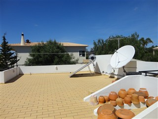 Roof terrace with solar panels and sat. dish